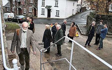 Blacksmith Dave Denford walks past the railings he constructed