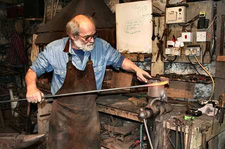 The blacksmith making the railings